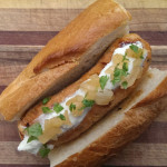 Nordic salmon and dill sausage with white wine/Brooklyn Pilsner sautéed onion and a horseradish cream sauce served in a crusty baguette